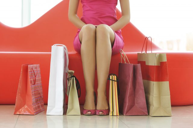 Woman with bags in shopping mall